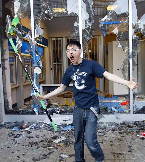 Asian kid with a hockey stick at the riots